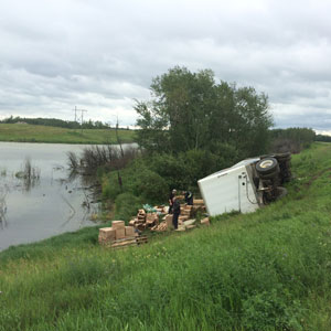Tipped truck with cargo spilled out